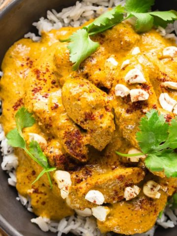 butter chicken in back bowl on rice
