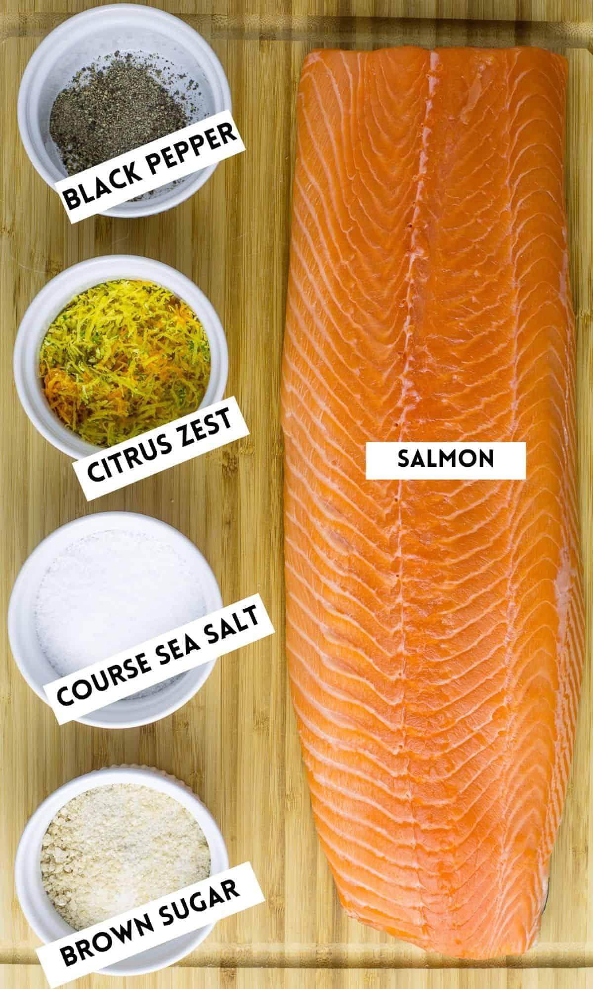 salmon citrus zest salt and pepper on wooden board