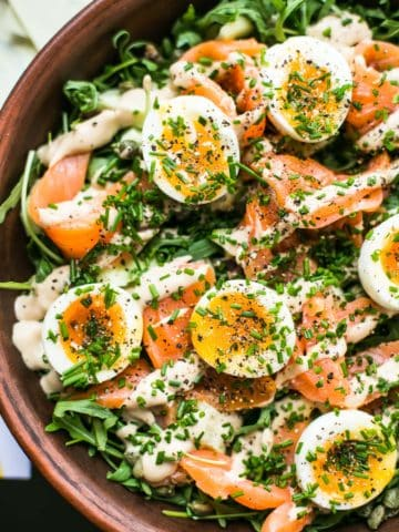 Home cured salmon salad with soft boiled egg and zingy anchovy dressing