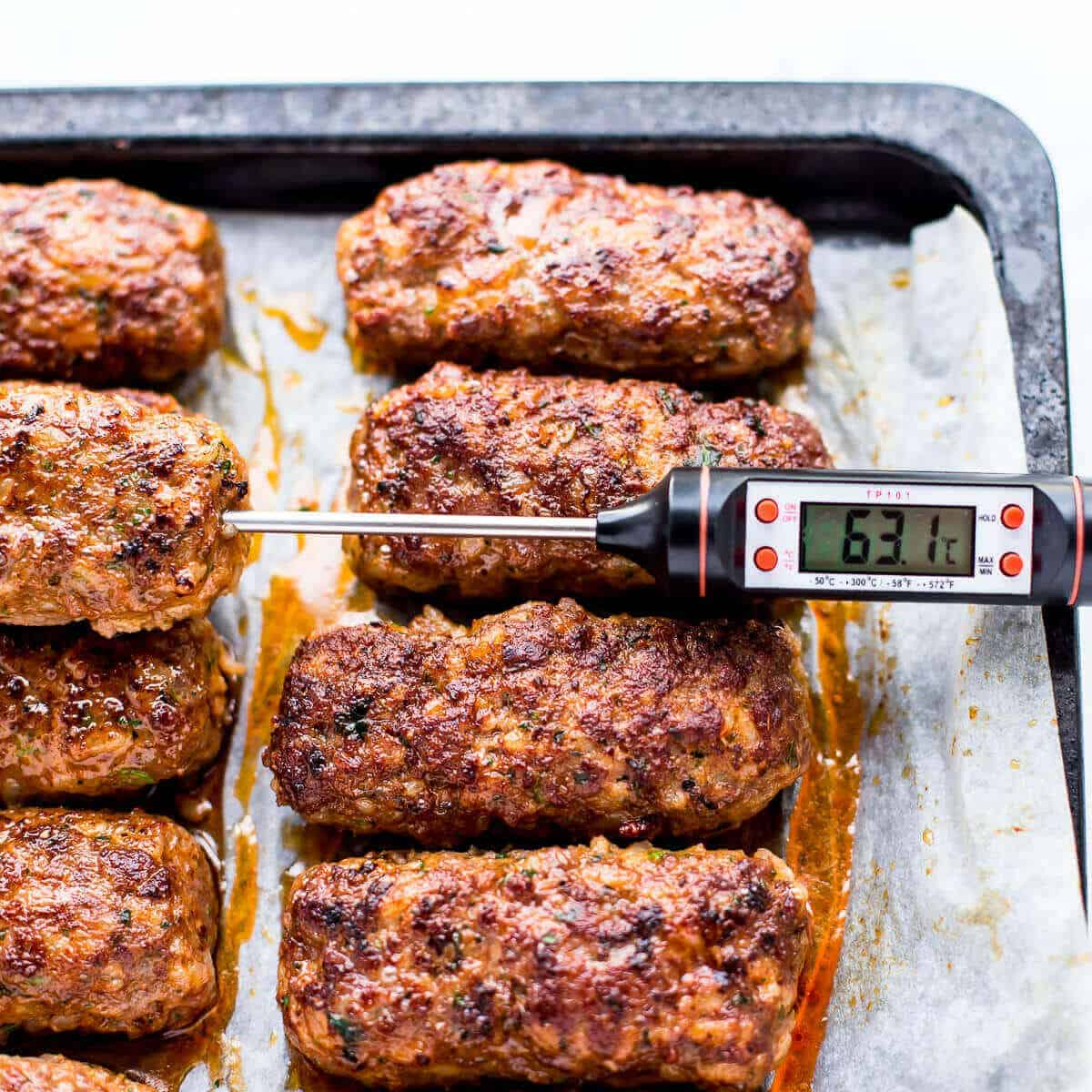 cooked beef koftas on white parchment