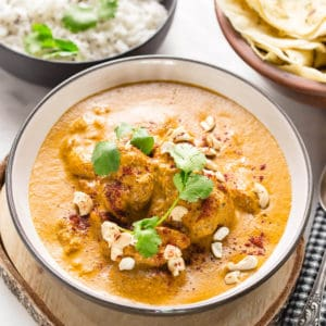 butter chicken in a white bowl