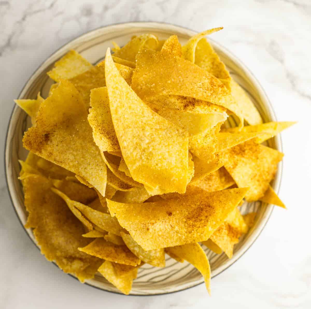 corn tortilla chips on a beige plate