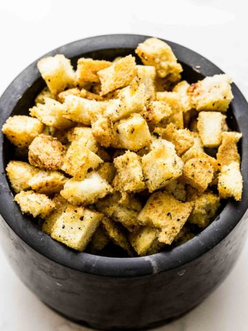 This homemade croutons recipe can be made with only 3 ingredients. Bonus 3 optional ingredients included in recipe. These homemade croutons will transform the way you cook by giving you that extra secret ingredient you can add to salads, soups and stews.