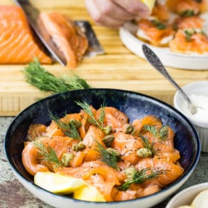 sliced cured salmon in blue bowl