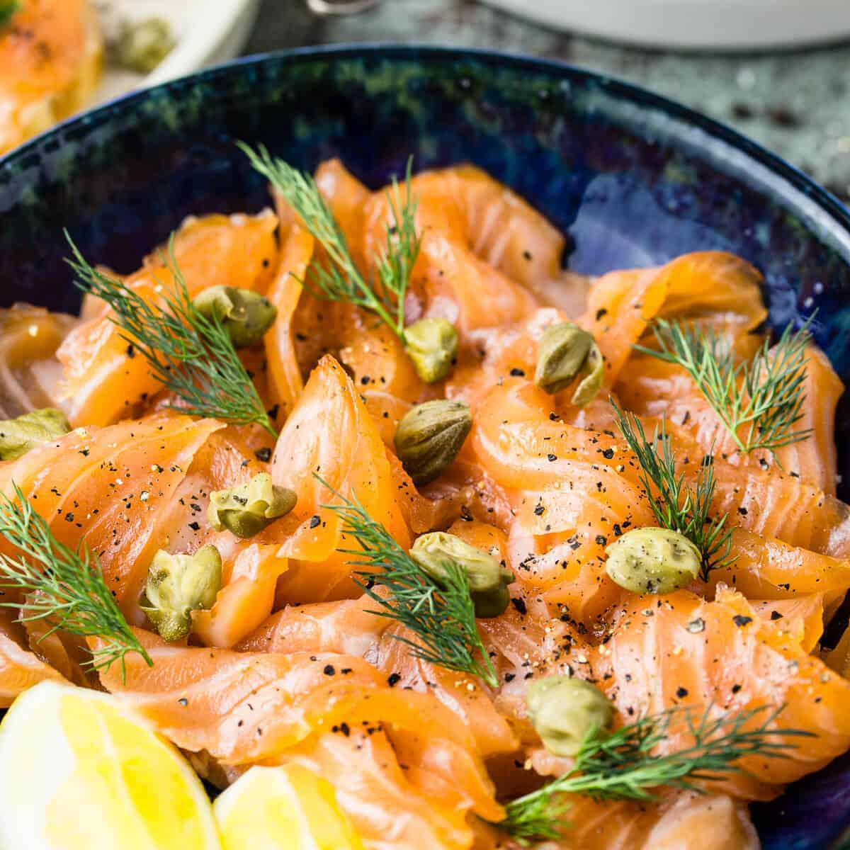 sliced cured salmon gravlax with dill and capers