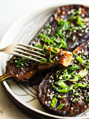 miso baked eggplant with spring onion and toasted sesame seeds