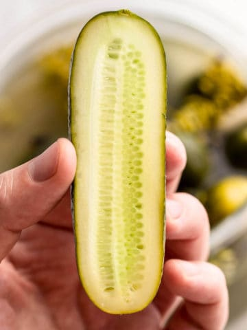 fermented cucumber cut in half
