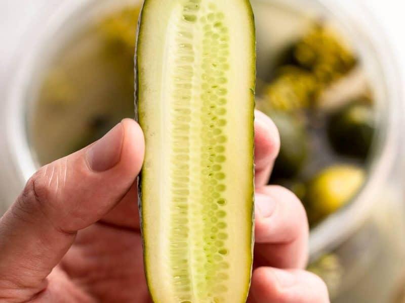 fermented cucumber cut in half