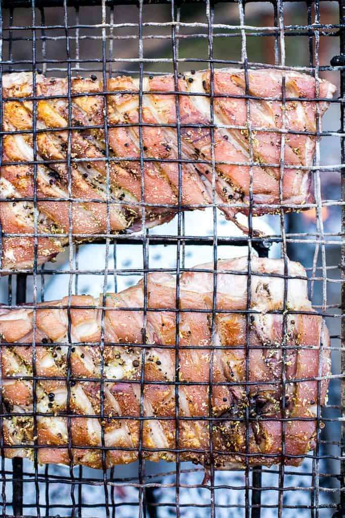 crispy pork belly on black grill