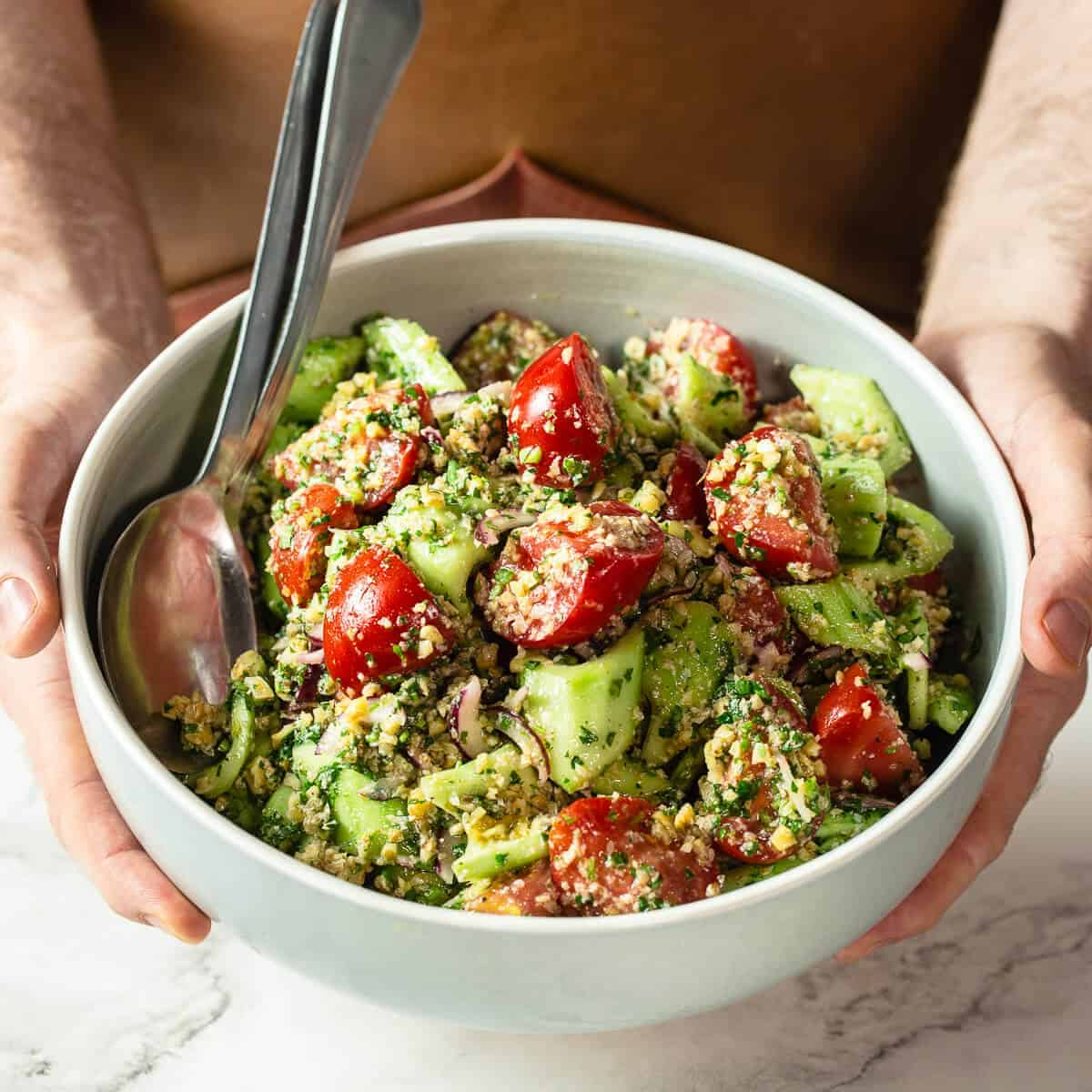 georgian salad in green bowl.