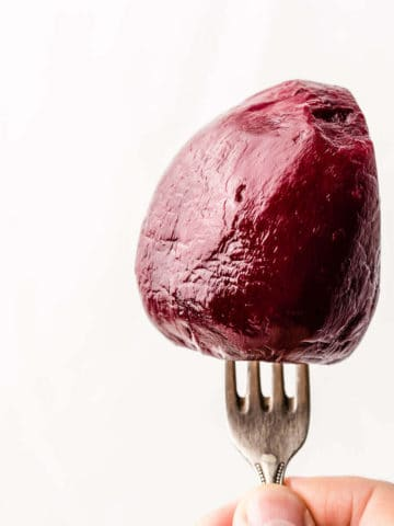 peeled and cooked red beetroot on a fork