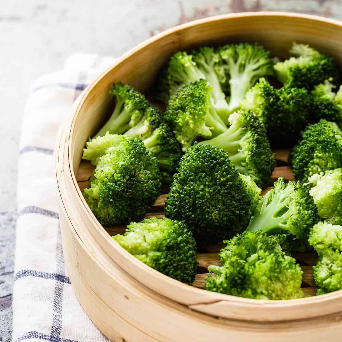 cooked broccoli in a steamer basket