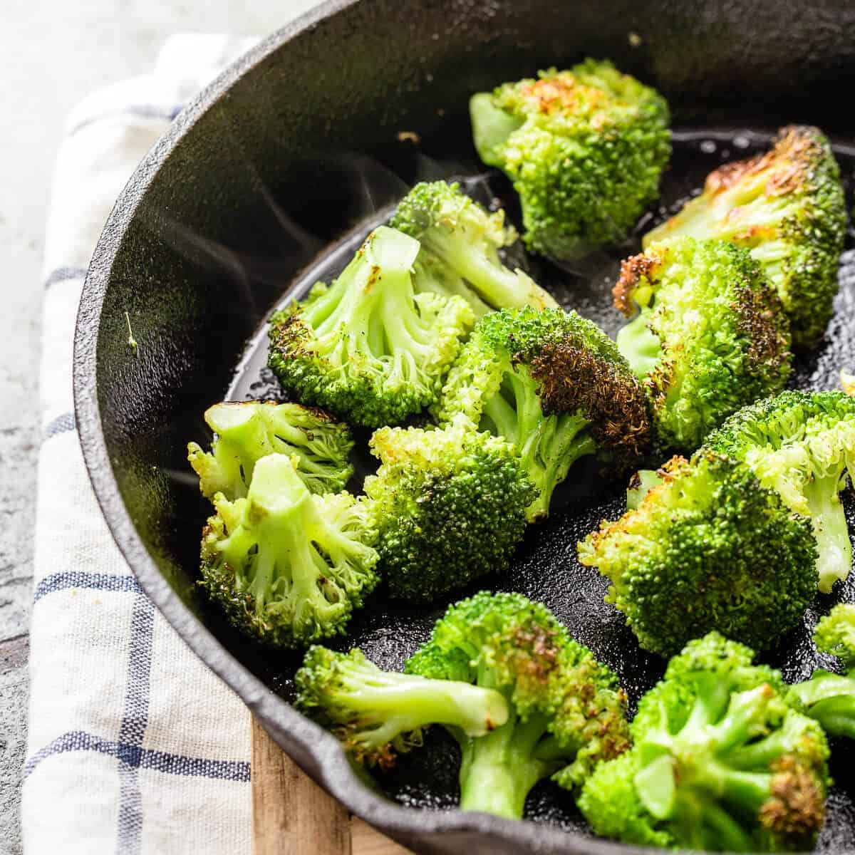 cooked broccoli in a cast iron pan