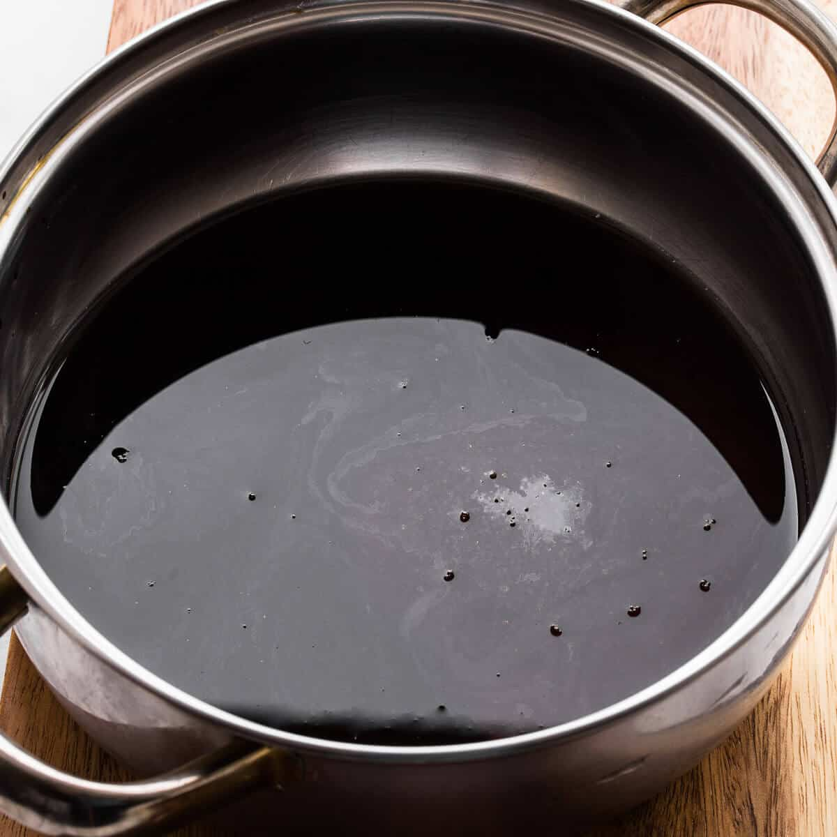 soy sauce, water, sugar and molasses in a sauce pan