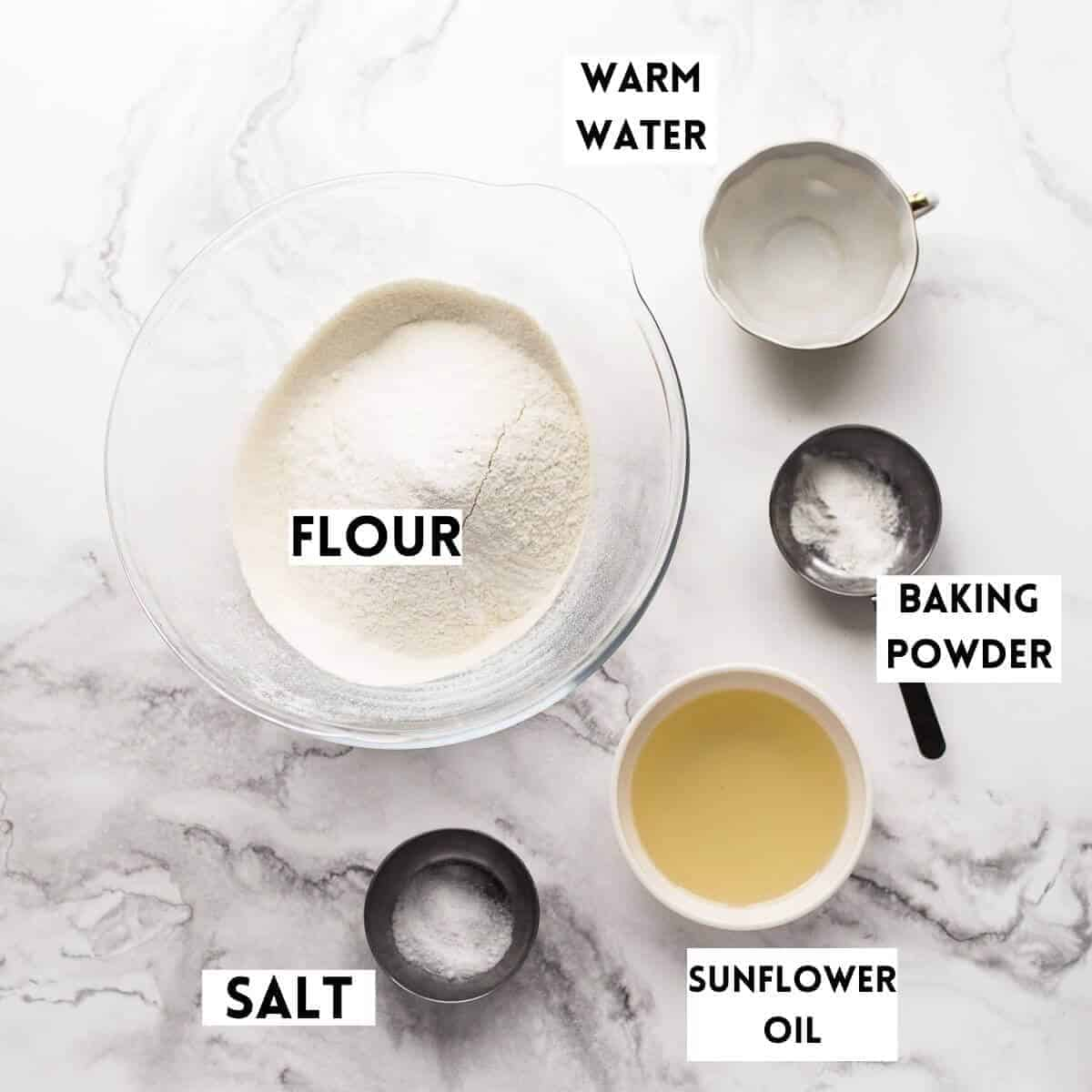 ingredients-for-making-homemade-flour-tortillas on marble background