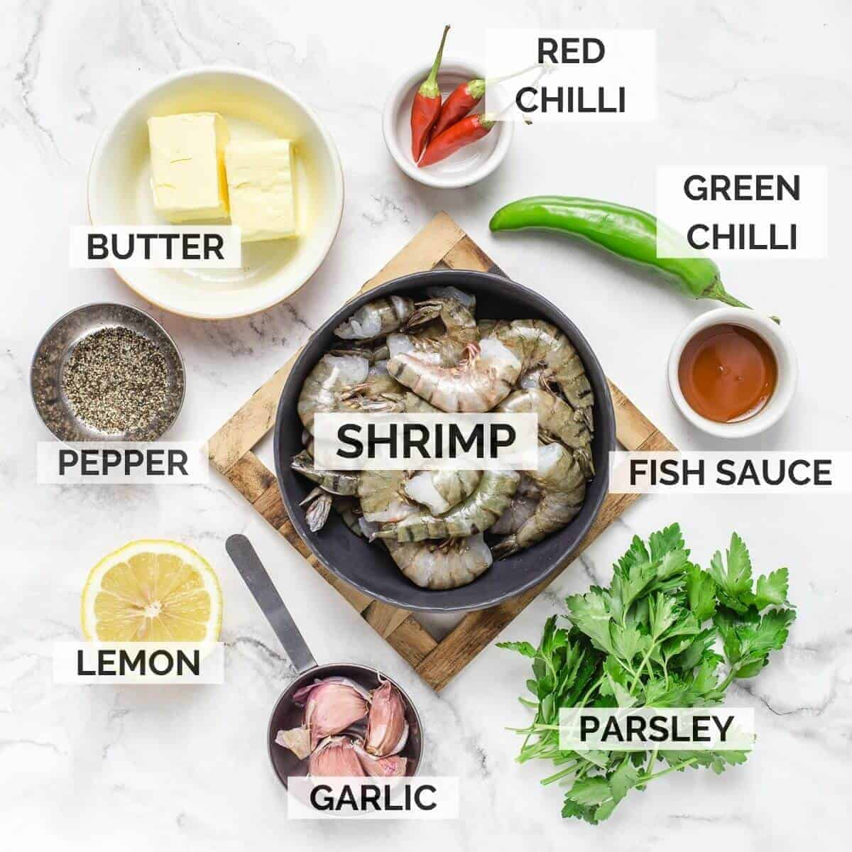 ingredients for making this recipe. butter, chilli red, chilli green, parsley, shrimps, pepper, lemon, garlic, fish sauce