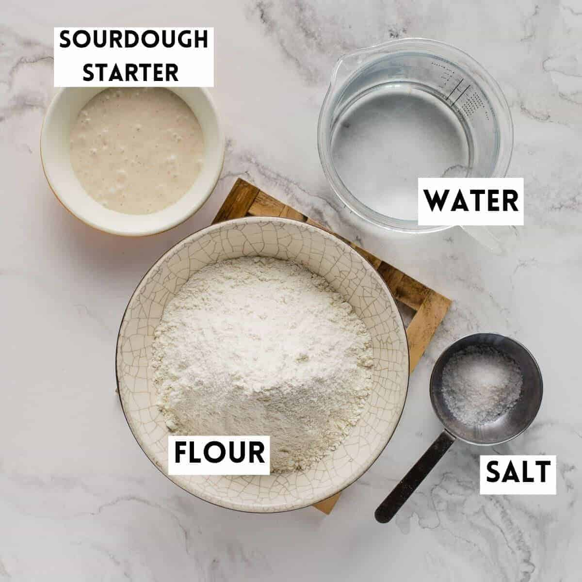 flour, water, salt and sourdough starter in separate bowls