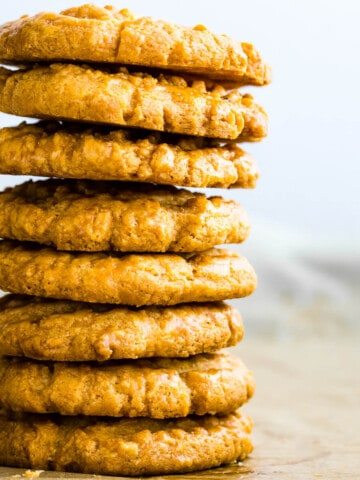 parmesan sablé cookies stacked on top of each other.