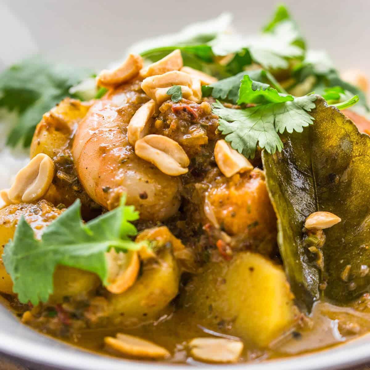 prawn massaman curry closeup in white bowl.