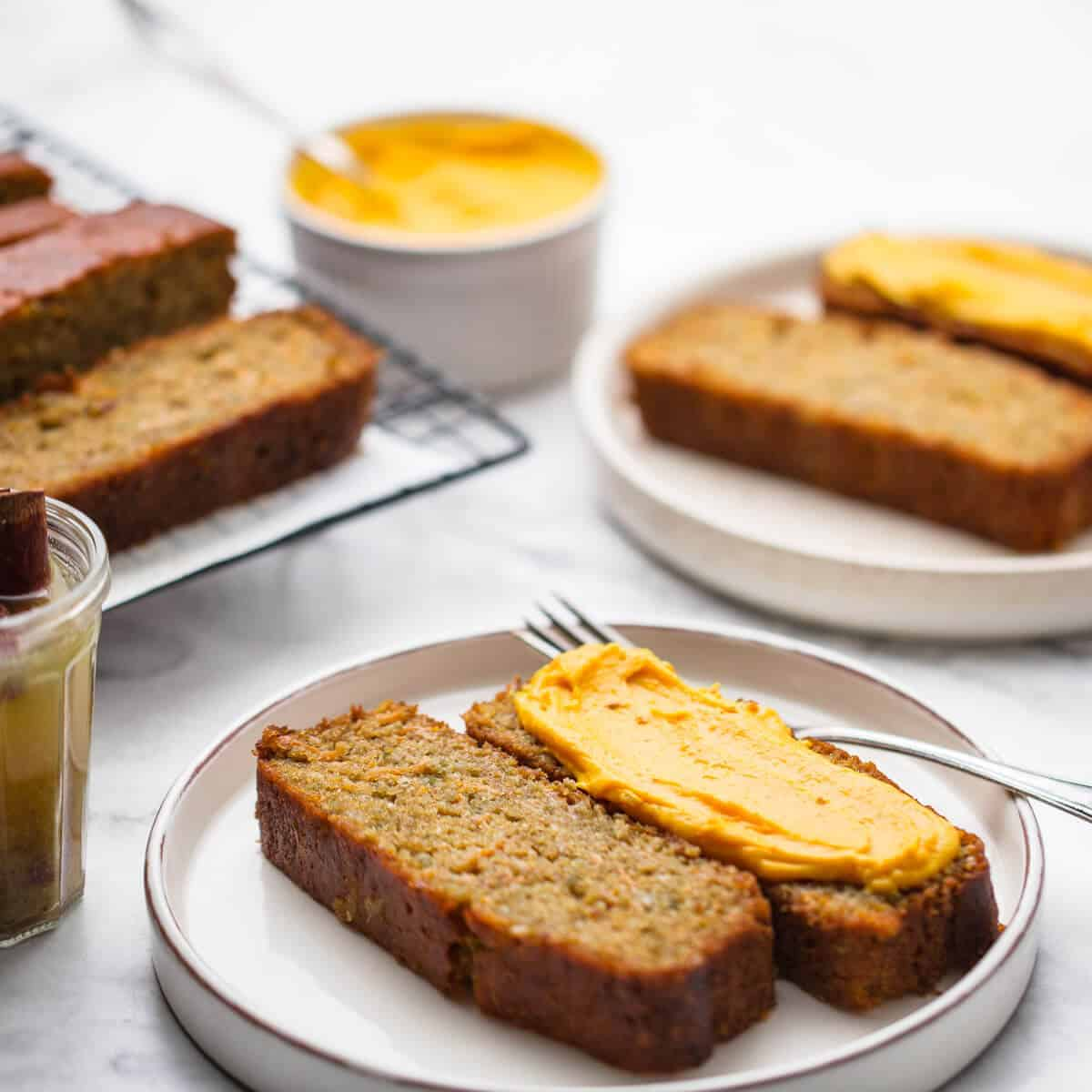 pumpkin cake with syrup and cream cheese spread