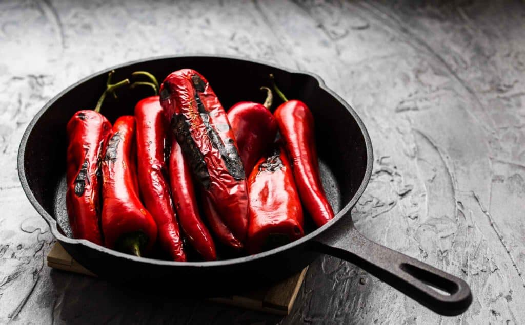 roasting red peppers in a skillet