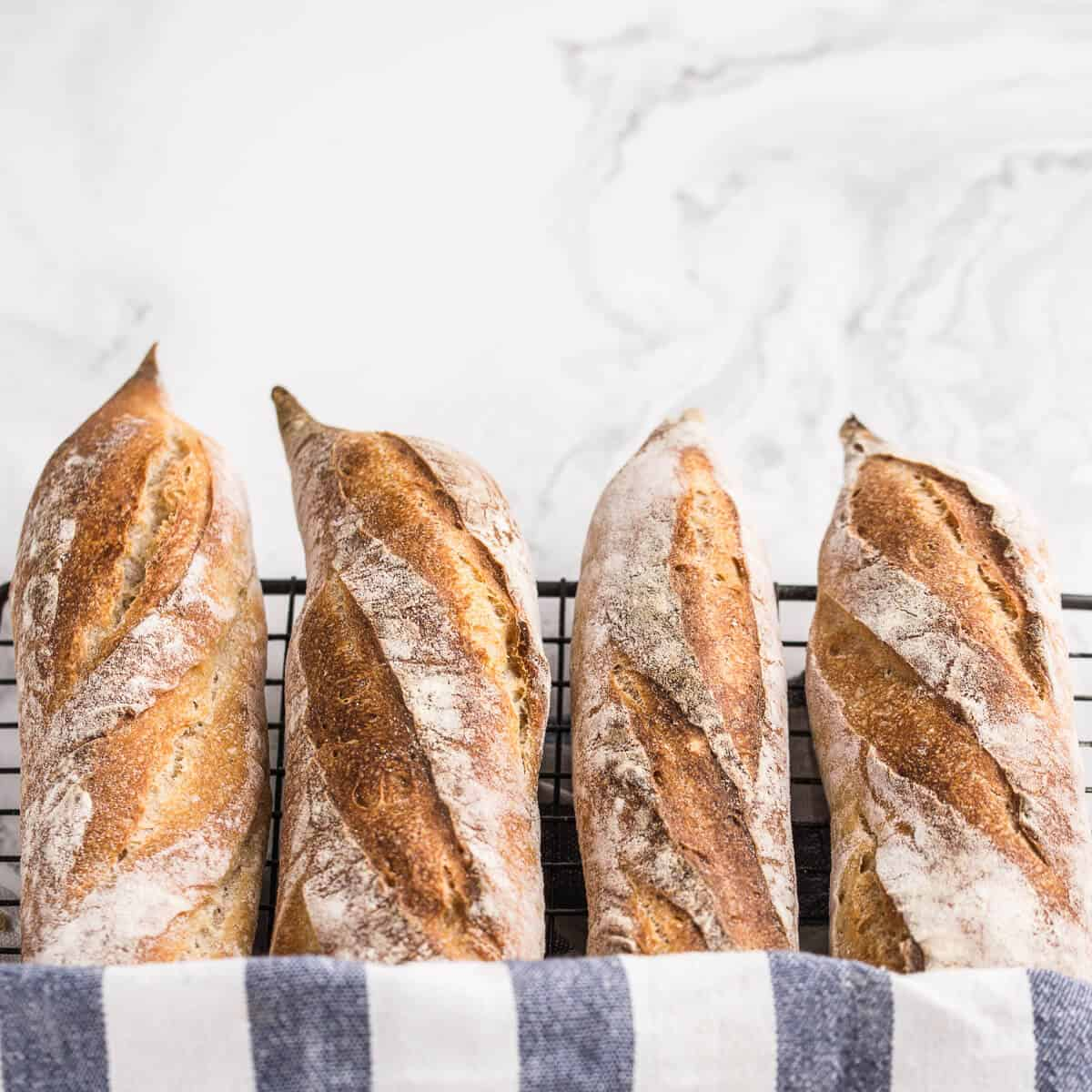 four baguettes on wire rack