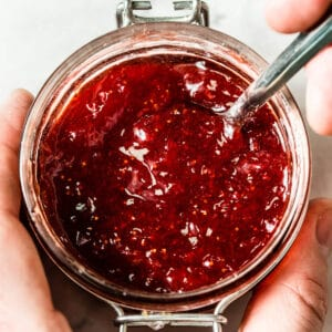 red strawberry jam in clear glass jar viewed from the top